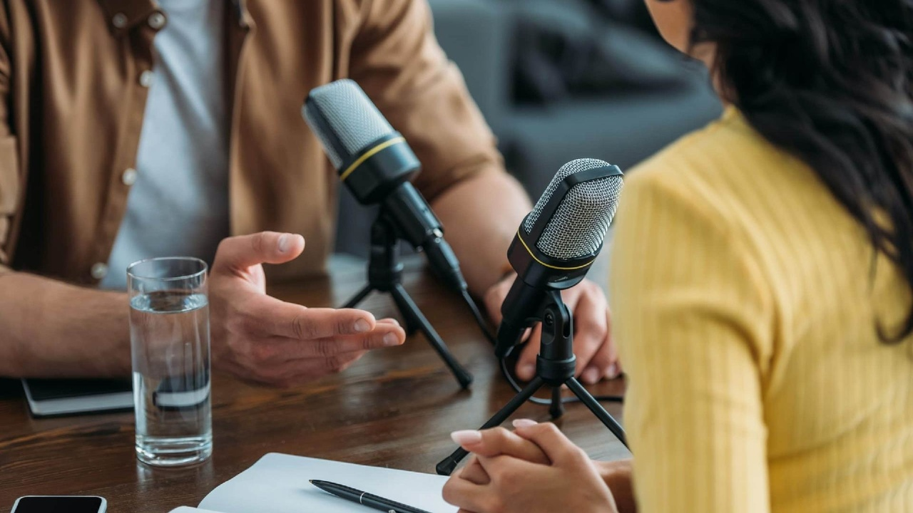a man and a woman recording a podcast for their digital marketing campaign