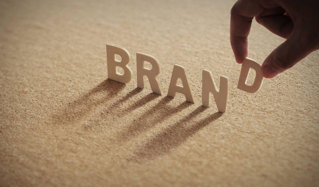 Compressed with human finger on letter D, Brand letter