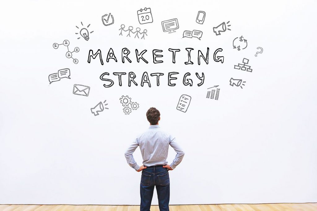 Writing marketing strategy on whiteboard