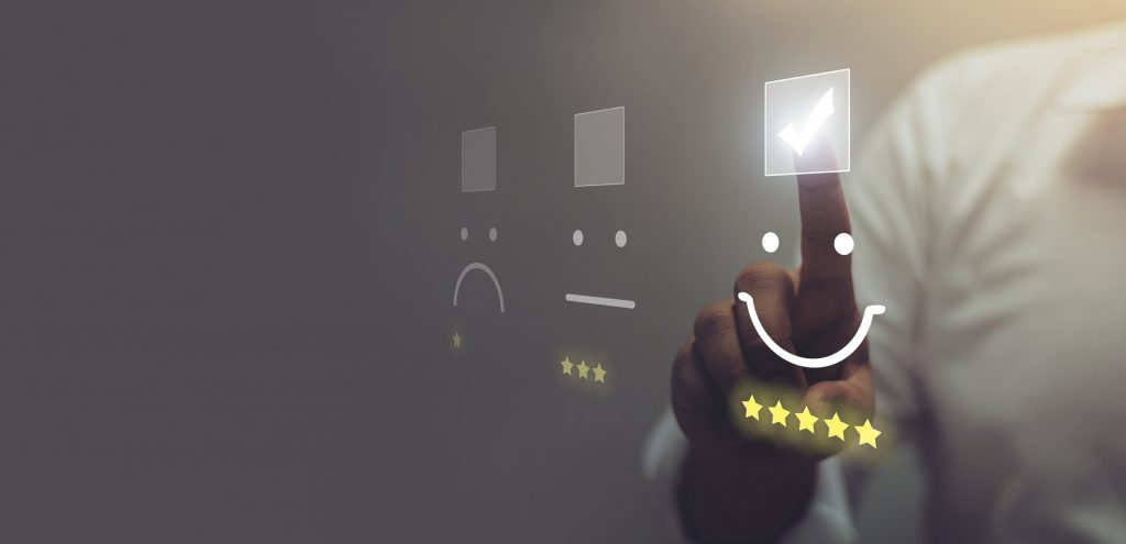 Businessman pressing smiley emoticon on virtual touch screen. Customer service evaluation concept.