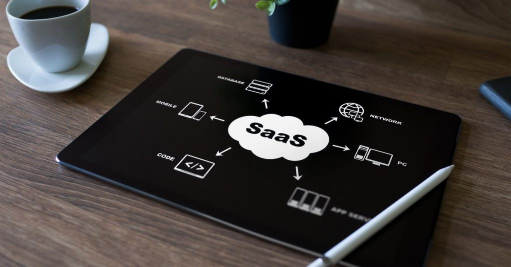 SaaS - software as a service. Internet and technology concept.Saas cover photo, ıpad, pen, what is a SaaS
