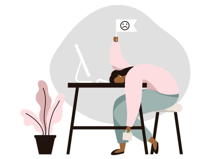 Work burnout. Tired female worker sitting at the table. Long working day in the office. Mental health problem.